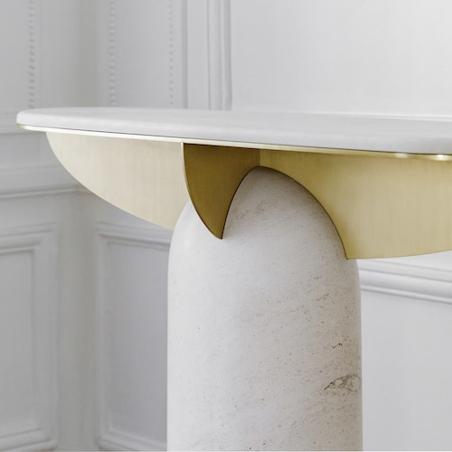 Close-up of travertine console 03 by Frederic Saulou with brushed brass detailing