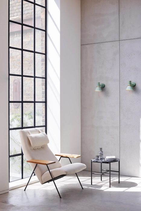 Seating corner in a contemporary interior with green wall lights