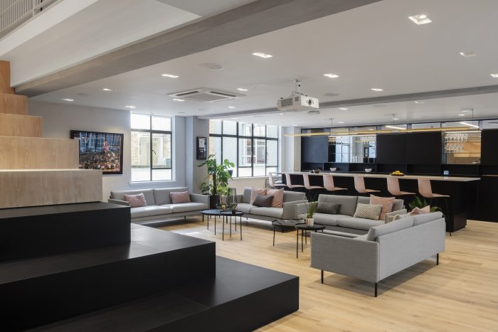 Office interior with grey sofas