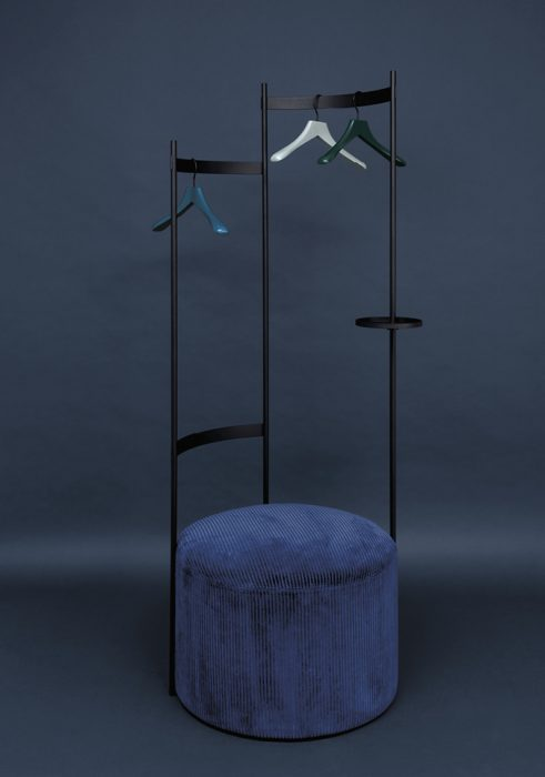 The Tilda wardrobe by Schoenbuch with a pouf upholstered with a blue corduroy fabric